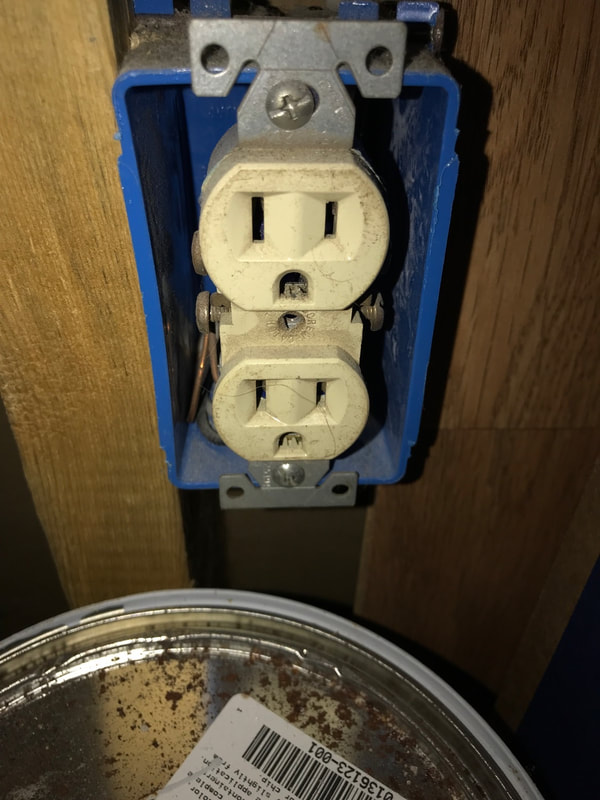 Electrical receptacle/outlet without a cover and wires exposed observed by Dairyland Home Inpsection.