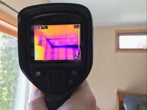 Flir E6 thermal image camera during home inspection
